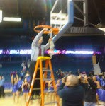 DePaul Blue Demons Coach Doug Bruno cuts down the net as Big East champions