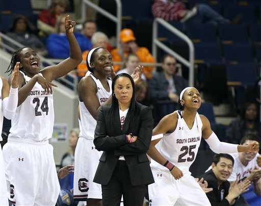 The steely stare of South Carolina's Dawn Staley with Aleighsa Welch, Alaina  Coates, and Tiffany Mitchell's joy. Hey, you're a #1 seed...lighten up!