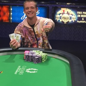 Adrian Buckley with the gold bracelet and winning hand