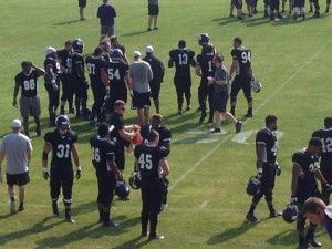 Players take the field at practice